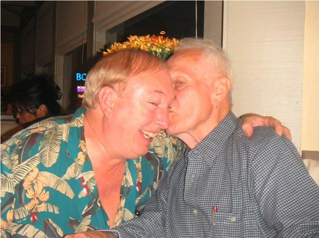 Dad kissing my brother Doug
